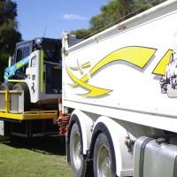 Truck Hauling Bobcat Skidsteer